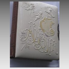 1897 Victorian Celluloid Photo Album w/3 Embossed Cherubs on Front & Inside Pages
