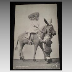 1905 Tuck Postcard of Dolls On & Off Stuffed Toy Donkey