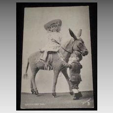 1905 Tuck Postcard of Dolls On & Off Stuffed Toy Donkey