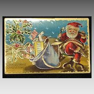 Antique Embossed Postcard-Santa Behind Desk & On the Phone with Bag of Toys-Merry Christmas Series 403-Unused