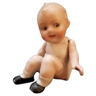 Vintage German Sitting Bisque Googlie Doll with Jointed Arms.