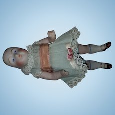 "Adorable 4 3/4"" All Bisque Doll with Original Outfit"