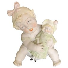 Amusing Bisque Toddler Holding Doll Figure