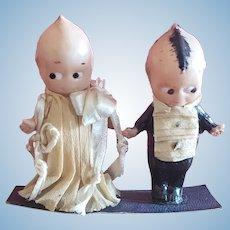 """Vintage 2 1/4"""" Celluloid Kewpie Bride and Groom Doll Pair"""