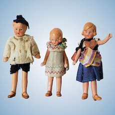 Three Vintage Painted Bisque Dollhouse Dolls in Original Clothing