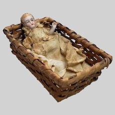 "2- 1/2"" German Bisque Baby Original Outfit in Antique Basket"