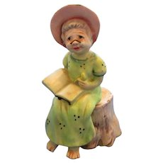Norcrest China  Woman Reading While Sitting on Stump Salt and Pepper Shakers