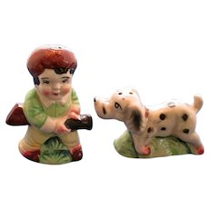 Boy In Daniel Boone Cap and Pointing Hunting Dog Salt and Pepper Shakers