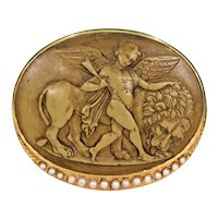Intricately Carved Lava Cameo Brooch Showing Cupid and the Lion with Graduated Pearls