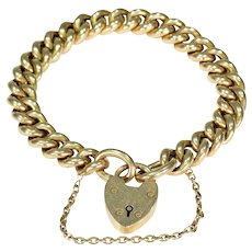 Fantastic 15k Yellow Gold Curb Link Bracelet with Heart Lock