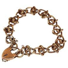 Edwardian Gold Fancy Link Heart Lock Bracelet