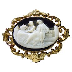 1825 Brooch of a Two Part Cameo in Gold Repousse Setting