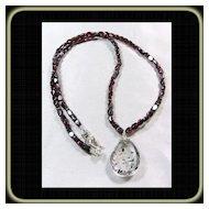 Super Seven Crystal on Garnet Bead Necklace