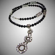 White Buffalo Pendant on a Necklace of Black Agate with Sterling Beads