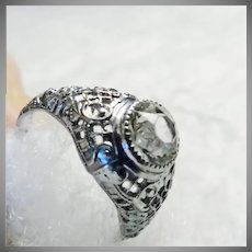 1920s-1930s White Metal Filigree Ring with Clear Crystal