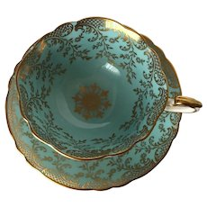 PARAGON Turquoise Blue with Rich Gilt Overlay Tea Cup and Saucer