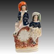 Staffordshire Figure Of Children Beside Faux Clock, 1860