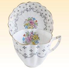 Victoria England Porcelain Tea Cup and Saucer Set