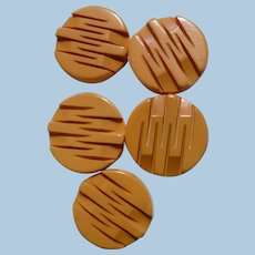 Five Carved Bakelite  Buttons