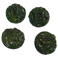 Four Carved Bakelite Buttons