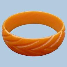Orange Bakelite Carved Bracelet