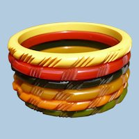 Six Multi color Bakelite Spacer Bracelets
