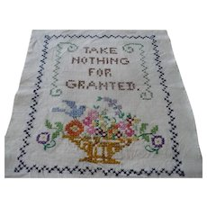 Embroidered motto  Take Nothing For Granted