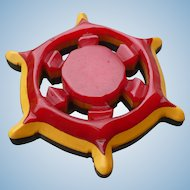 Bakelite Three Color Ships Wheel Pin