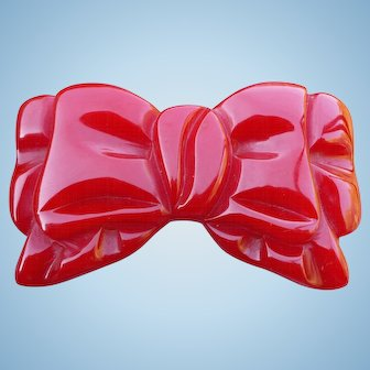 Red Bakelite Bow Pin