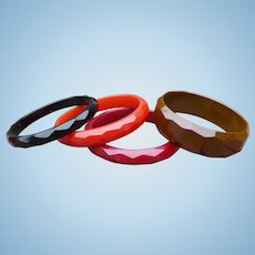 Four Bakelite Carved Bracelets