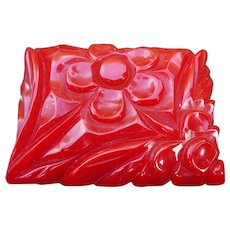 Red Bakelite Carved Pin