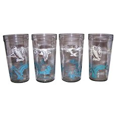Vintage 1950's Swanky Swag GlasswareVintage set of four 1950's swanky swag glassware. This nifty set of everyday glassware features a two color applied paint motif of flying ducks and flying ducks from a water marsh background. Each glass has the sam