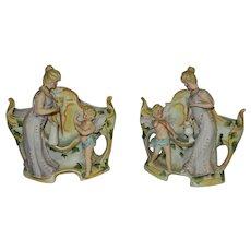 Vintage Pair of  Lady and Cherub Porcelain Planters