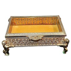 Vintage 24kt Gold Plated Ormolu Jewelry Casket with Cherub Legs and Beveled Glass.