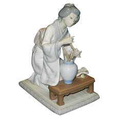 Vintage Lladro Retired Figurine of Geisha Arranging Flowers in a Vase on a Low Bench