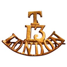 WWI The T.13.London Shoulder Title Badge