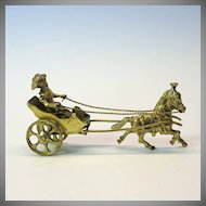 Early silver gilt cabinet figure of a lady in a pony drawn fancy cart