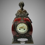 Art Nouveau bronze and Art Pottery mantle clock