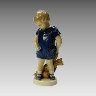 Vintage Royal Copenhagen boy with Teddy bear figure