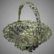 Early solid 800 silver repousse swing handle basket