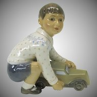 Dahl Jensen porcelain figure of a Boy with a toy car