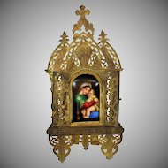 Painted porcelain religious plaque in gilt brass tall frame