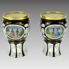 Pair of antique Bohemian overlay and enamel glass goblets glasses beakers with courting scene