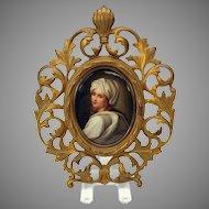 Fine hand painted porcelain portrait plaque in Victorian gilded cast iron frame