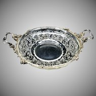 Signed Lobmeyr engraved glass center bowl with fancy silver floral frame and handles