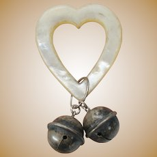 Antique heart shaped teething rattle with sterling silver bells