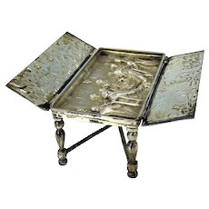 Antique Austrian silver miniature table-opens to reveal chess players scene