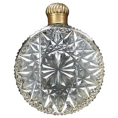 Circular or round antique cut glass flask bottle