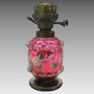 Antique enameled cranberry cased glass oil lamp with Morning Glories