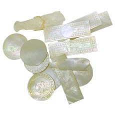 Set 13 Chinese engraved assorted Mother of Pearl game chips 1800's